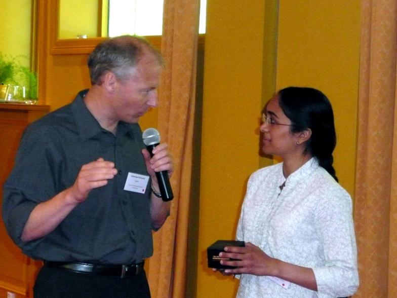 2009 IISW Best Poster Award presented by Johannes Solhusvik to Gayathri Nampoothiri of Delft University